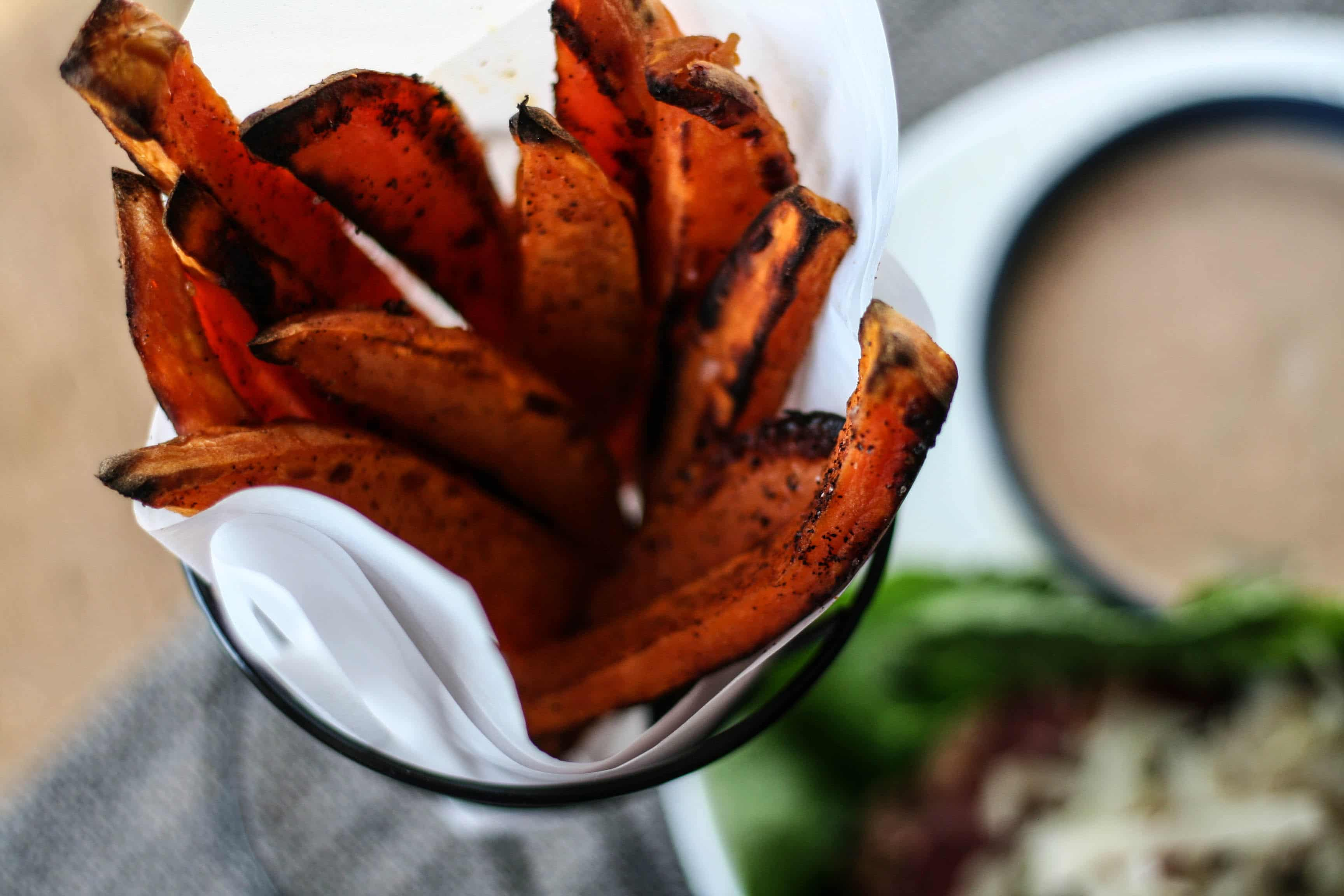 a basket of spicy sweet potato fries